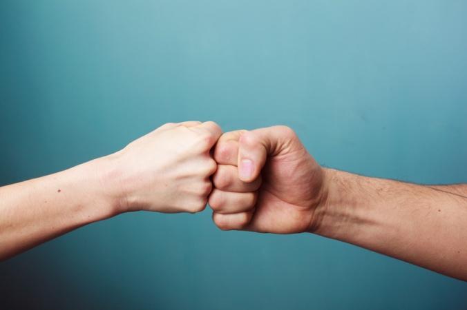 fist-bump-shutterstock_176659706
