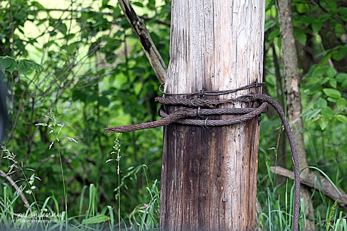 broken rope wire on fence post