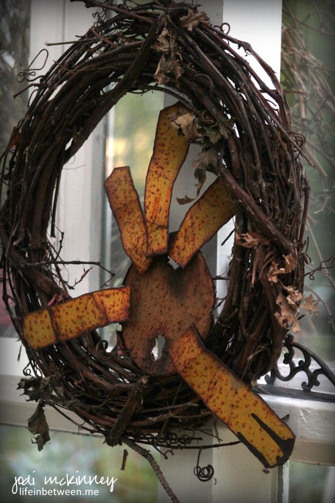 rusty sun grapevine wreath