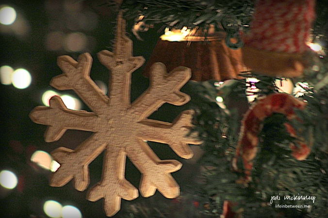 Wooden snowflake on christmas tree 2015
