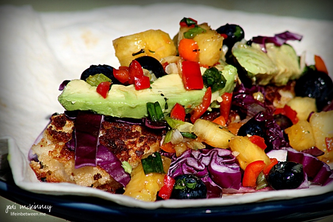 fish tacos with pineapple blueberry salsa red cabbage and avocado
