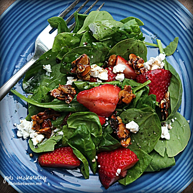 spinach strawberry salad with candied almonds and goat cheese