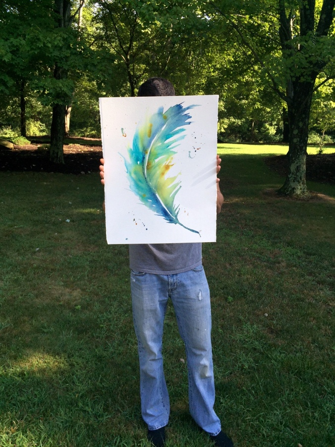 Nick holding Watercolor Blue Feather 17x22