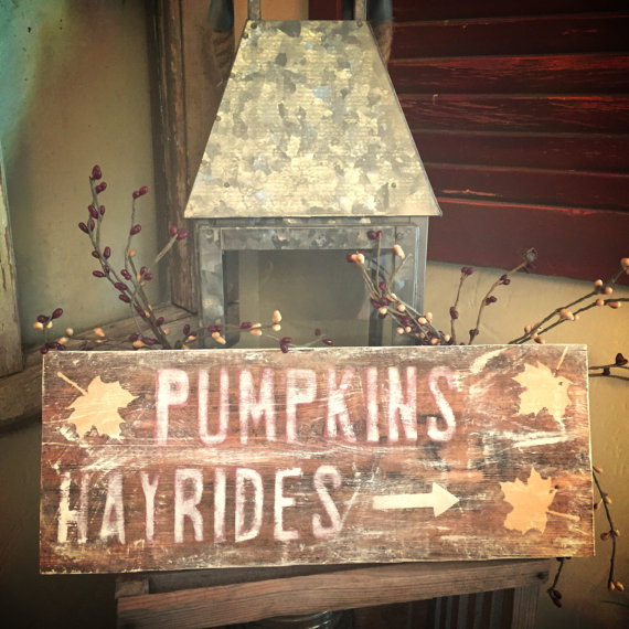 pumpkins and hayrides sign